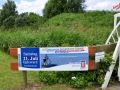 Schlickschlittenrennen 2012 - Plakat am Trockenstrand von Upleward